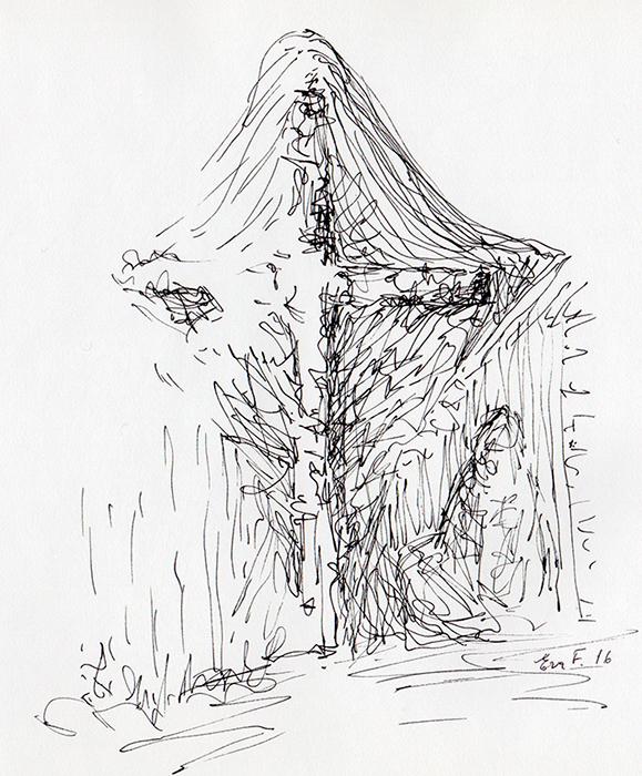 En der sidder ved et kors